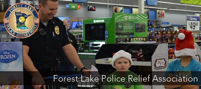Photo of a Police Officer with some kids at the Shop with a Cop Event